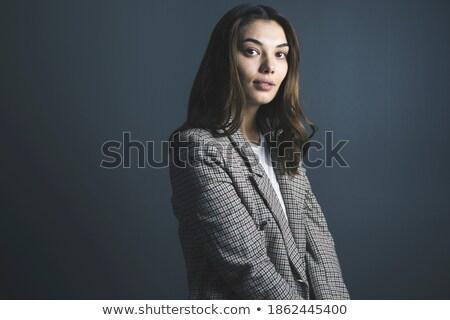 Elégedett ázsiai nő kabát pózol néz Stock fotó © deandrobot