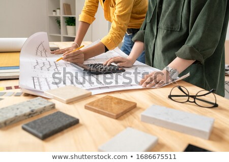 Businesswoman unrolling blueprint Stock photo © IS2
