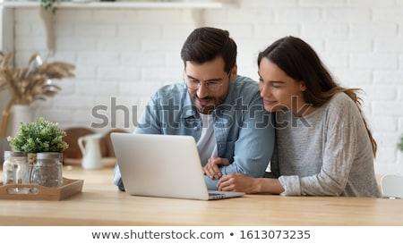 Férj feleség laptop nő kommunikáció nappali Stock fotó © IS2