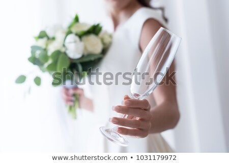 selective focus of bride with wedding bouquet holding empty champagne glass Stock photo © LightFieldStudios