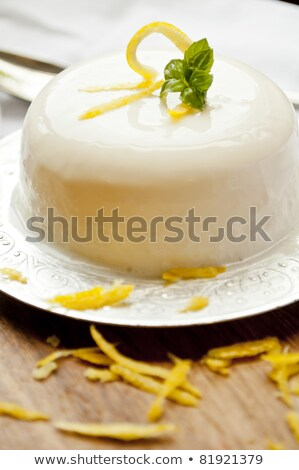glass of lemon panna cotta stock photo © mpessaris