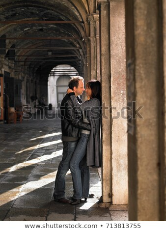 Venice couple embracing in colonnade Stock photo © IS2