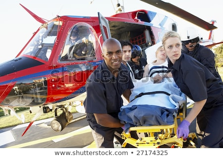 Paramedics unloading patient from Medevac stock photo © monkey_business