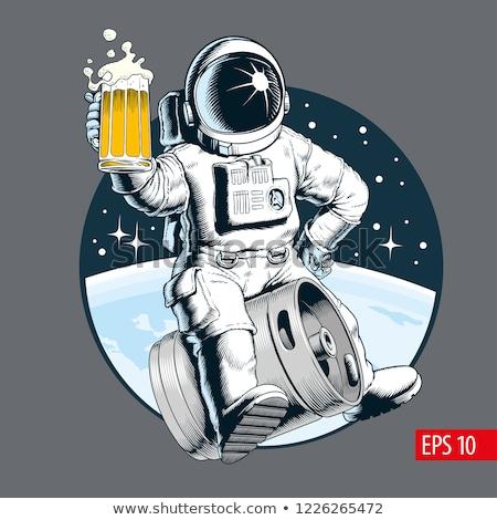Astronaut with a mug of beer Stock photo © studiostoks