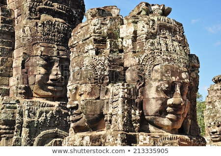 Temple souriant visages Cambodge pierre Photo stock © romitasromala