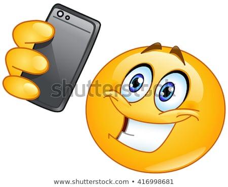 Emoticon with smart phone Stock photo © yayayoyo