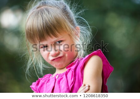 Portrait of an annoyed young girl in summer dress Stock photo © deandrobot