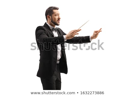 portrait of elegant perfomer conducting a concert with a baton Stock photo © feedough