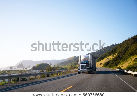 Stock photo: truck driving along the road