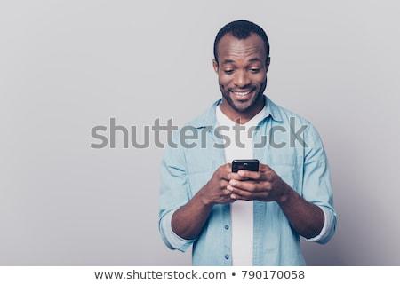 Stok fotoğraf: Heyecanlı · genç · gündelik · adam · cep · telefonu