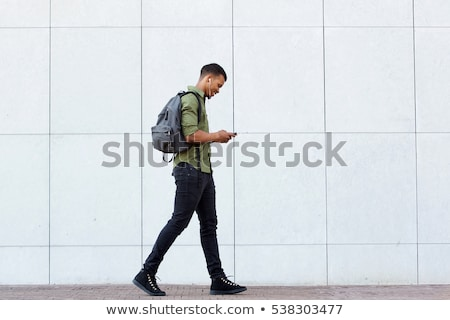 スマート · 少年 · 徒歩 · 歩行者 · 笑顔 · 子供 - ストックフォト © deandrobot