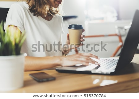 Stock photo: businesswoman with tablet pc and coffee at office