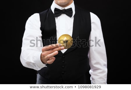 close up of casino dealer holding ethereum coin Stock photo © dolgachov