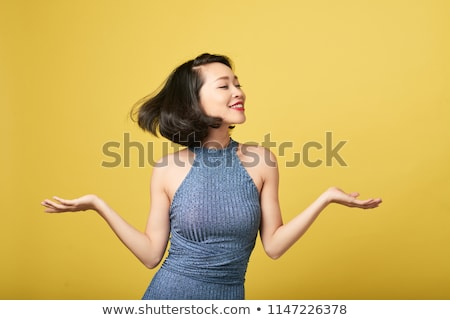 Portrait of a smiling young asian woman Stock photo © deandrobot