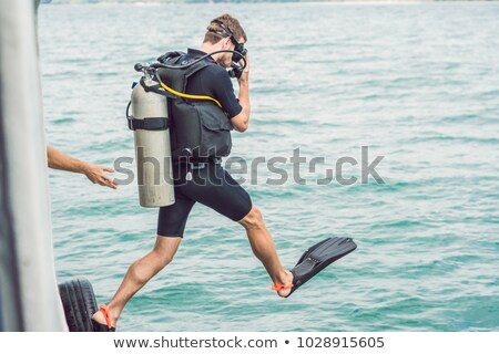 Divers jump in the sea to start diving stock photo © galitskaya