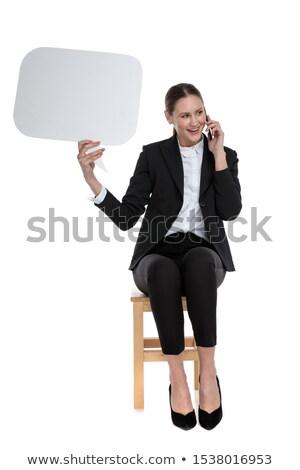 Assis femme d'affaires parler téléphone bulle blanche Photo stock © feedough