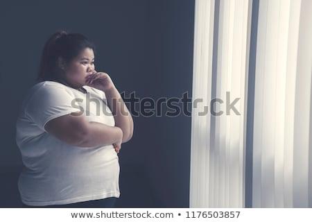 Confusi giovani sovrappeso donna piedi isolato Foto d'archivio © deandrobot