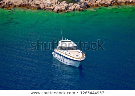 Yacht anchored in hidden turquoise bay of Croatian archipelago Stock photo © xbrchx
