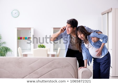 jovem · chinês · homem · telefone · móvel · sofá · casa - foto stock © dolgachov
