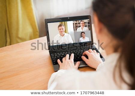 üzletasszony laptopot használ webkamera számítógép mosoly arc Stock fotó © vladacanon