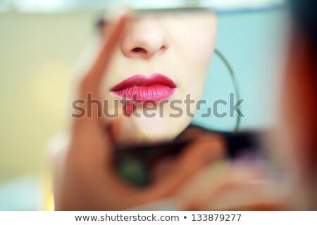 retrato · nina · lápiz · de · labios · labios · mirando · espejo - foto stock © studiolucky