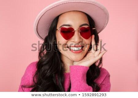 Foto encantador mujer largo pelo oscuro gafas de sol Foto stock © deandrobot