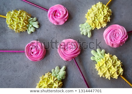 cool sweet meringues in the pineapple and roses form stock photo © dashapetrenko