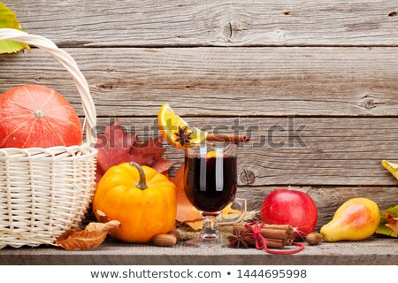 Autumn still life with mulled wine and pumpkins Stock photo © karandaev
