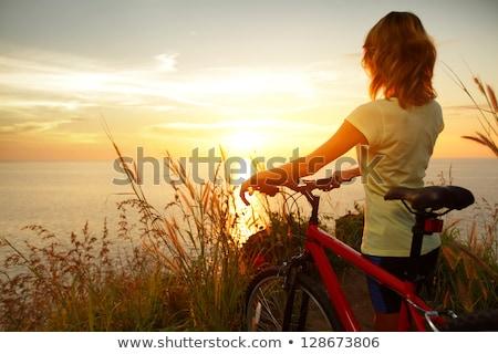 kobieta · rowerowe · parku · afro · pani · jazda · konna - zdjęcia stock © robuart