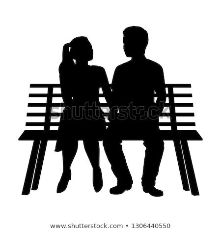 Para posiedzenia ławce romantyczny pary dating Zdjęcia stock © robuart