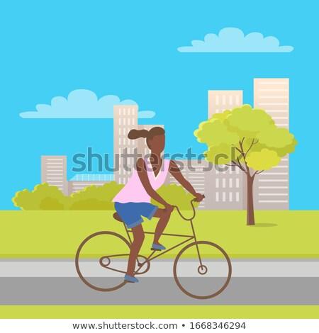 teenage girl bicycle cartoon character buildings stock photo © robuart