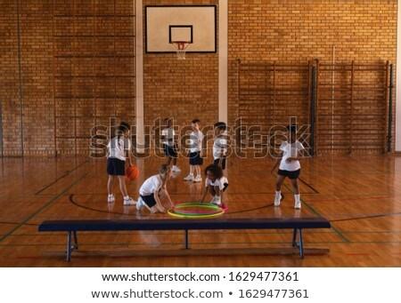 далеко школьников играет баскетбол баскетбольная площадка Сток-фото © wavebreak_media
