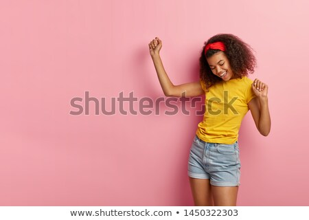 One happy girl in yellow shirt Stock photo © bluering