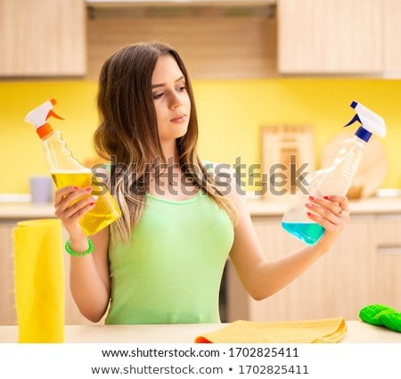 The young beatifull woman polishing table in the kitchen  Stock photo © Elnur