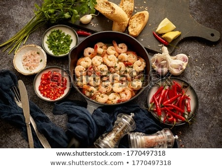 Tasty shrimp tails fried in butter with, garlic, parsley, white wine chili. With various ingredients Stock photo © dash