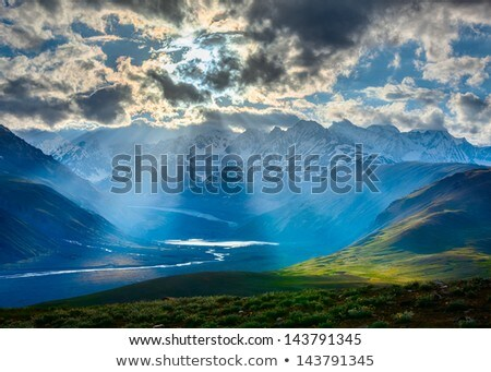 Sun rays through clouds in Himalayan valley in Himalayas Stock photo © dmitry_rukhlenko