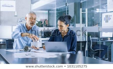 Female architect correcting designs Stock photo © photography33