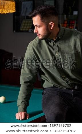 Jóképű férfi öltöny ül biliárd medence pózol Stock fotó © lunamarina