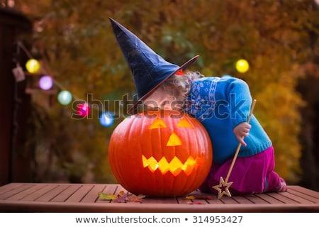 little girl carving pumpkin stock photo © photography33