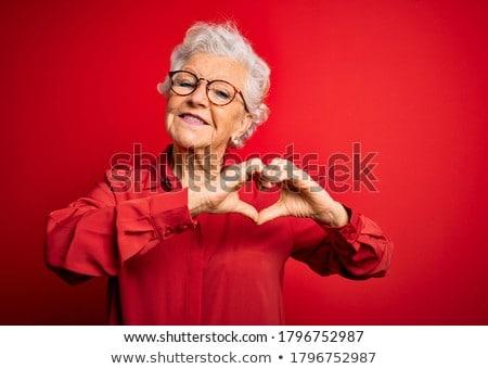woman showing heart shape gesture Stock photo © dolgachov