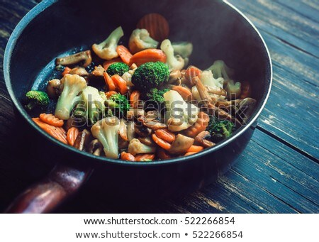 pan fried vegetables and mushrooms stock photo © nessokv