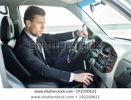 young successful businessman riding in the car stock photo © hasloo