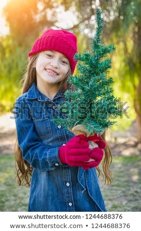 Cute Mixed Race Young Girl Wearing Red Knit Cap and Mittens Hold Stock photo © feverpitch