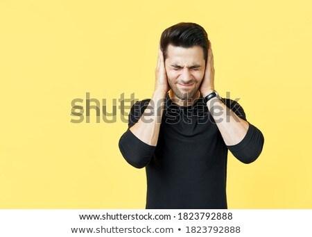 Yakışıklı adam kulaklar eller kötü haber Stok fotoğraf © GVS