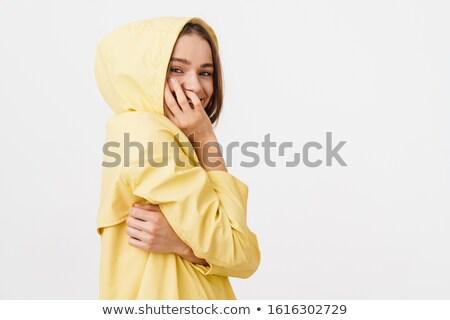 Fotó vicces kaukázusi nő esőkabát pózol Stock fotó © deandrobot