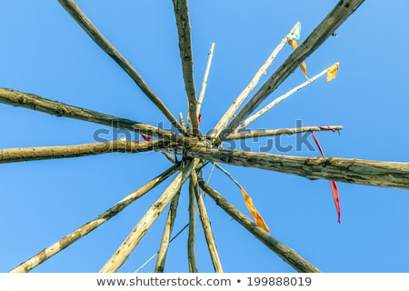 tipee stakes and ribbons shown against a blue sky stock photo © meinzahn