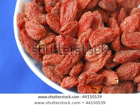 Goji Berries Also Called Wolfberries Isolated On Blue Stok fotoğraf © JohnKwan