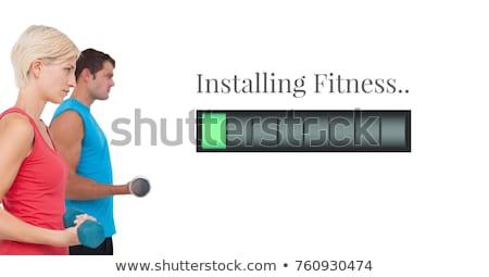Imagine muscular cuplu greutate Imagine de stoc © wavebreak_media
