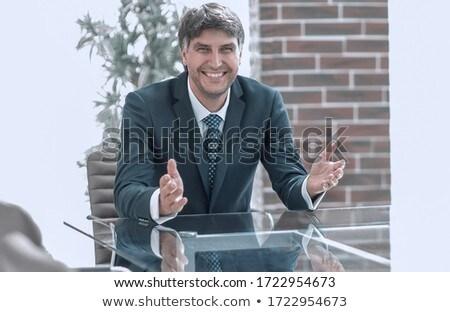 üzletember ül üres hely laptop izolált fehér Stock fotó © cherezoff