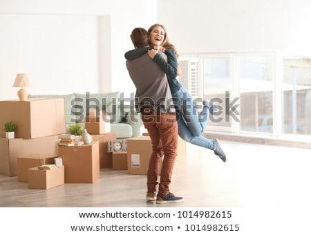 happy couple hugging at new home Stock photo © dolgachov